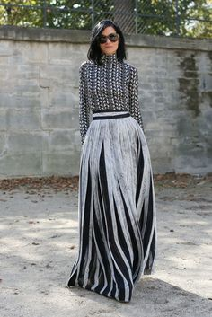 Street Style: Black and white long pleated skirt, stretch pullover and oversized sunglasses at Paris Fashion Week, Spring 2014.