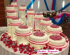 Wedding Cake Stand Cascade waterfall crystal set of 11 wedding acrylic cake stands with a battery operated LED light.