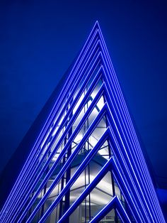 Devon Boathouse by Elliott + Associates Architects - South building corner on the edge of the Oklahoma River showing LED lighting.