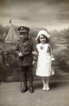 Children in soldier and nurse costume, WWI. Cute !