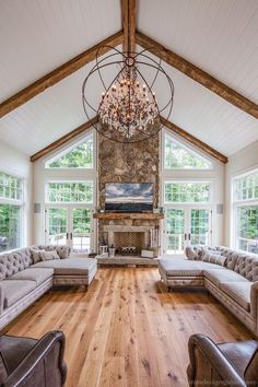 Perfect Great room vaulted ceiling exposed beams with beadboard ceiling wall of . Perfect Great room vaulted ceiling exposed beams with beadboard ceiling wall of windows rustic chan Living Room Decor Country, French Country Living Room, Stone Fireplace Wall, Cozy Fireplace, Fireplace Ideas, Fireplace Modern, Stone Fireplaces, Rustic Chandelier, Ceiling Chandelier