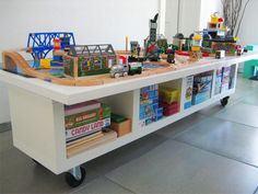 LACK shelving unit + door + casters = train table OR lego table!