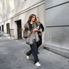 sneakers and pearls, street style, fur coat with white sneakers, trending now