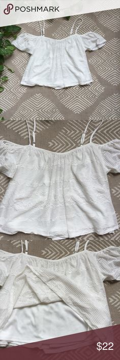 American Rag Off The Shoulder Top Super cute white off the shoulder top from Macy's. Has a lining underneath as seen in the third picture American Rag Tops Tank Tops