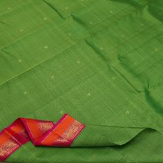 Luminous annapakshi buttis scatter their freshness on this freshly bathed, lush forest green #silk sari. The slim border is a riot of colour in neon pink and orange, embellished with horses,elephants and floral motifs in gold. The rich pink #pallu is ablaze with band of annapakshi, elephants and zari squares playing host to traditional motifs of chakrams, mayil and flying horses. For Kanjivarams in this alluring green, visit Sarangi. Code 640127041.