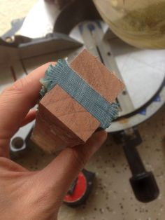 Epoxy bonded fabric to make a knife handle.  Interesting tutorial trimmed the end on the compound miter saw - looks so cool!
