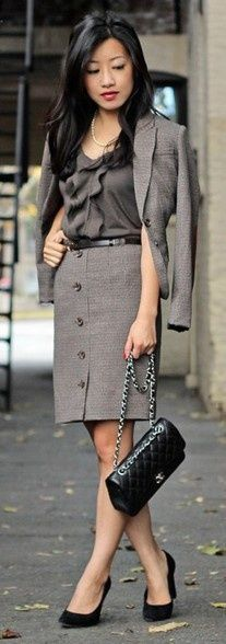 ...a totaly adorable asian model shows us how great a lady can look in her business outfit...