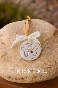 Handmade Angel Christmas ornament made with polymer clay and an angel stamp - so cute!