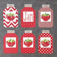 super cute quilt hanging on the wall of mygirlfriendsquiltshoppe Farm Girl Vintage Scrappy Strawberry block and Homemade Jam pattern