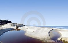 Stream of water in front of some concrete blocks on a  lonely beach, empty horizon, Baltic sea. Abandoned structures, military bunkers. Wide angle, panorama.The Baltic Sea.MORE BALTIC PHOTOS »