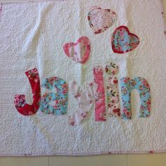 Cotton and clover dry goods made this quilt and they make many more cute things like this!! I love all the name quilts I think this may be a Christmas gift lol