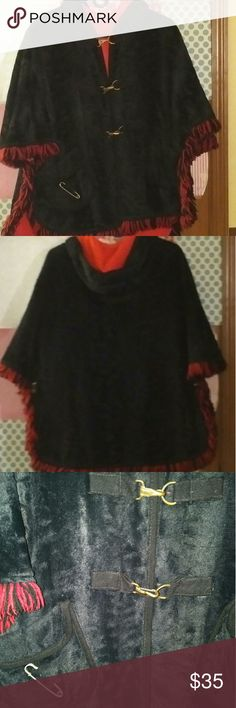 Vintage Parka Black with red fringe around the perimeter.  Red inside of hood as well. Safety pin accents one of the front pockets and two accent buttons on the back. Really fantastic piece. Jackets & Coats Capes