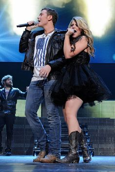 <I>American Idol</I> winner Scotty McCreery and runner-up Lauren Alaina delight fans at Nashville's Bridgestone Arena July 30, 2011.