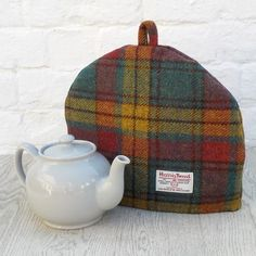 Here's a tea cosy that's different! This beautiful quality cosy has been handmade from the world renowned Harris Tweed handwoven fabric. I have chosen a multicolour tweed with slightly muted shades of rose pink, teal and yellow - a bit different to the. Teal Yellow, Yellow Fabric, Yellow Dress, Tea Cozy, Coffee Cozy, Tea Cosy Pattern, Harris Tweed Fabric, Teapot Cover, Textiles