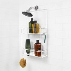 Inspired by the abstract art of Mondrian, the Umbra Cubiko Shower Caddy adds a modern touch and handy storage space to the bathroom. Bathroom Shelves, Bathroom Storage, Bathroom Ideas, Porta Shampoo, Hanging Shower Caddy, Bed Company, Design Industrial, Shampoo Bottles, Large Shelves