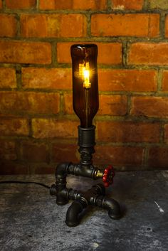 Upcycled Pipe Bottle Lamp  http://www.upcycledcreative.co.uk/online-shop/upcycled-pipe-bottle-lamp