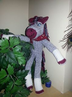 One day I was scrolling thru things to make for my grandson for Christmas. I came across this cute sock horse that was make just like a sock monkey. Now that Christmas is almost upon us I figured… Sock Monkey Pattern, Sock Monkey Baby, How To Make Socks, Sock Dolls, Sock Animals, Cute Socks, Dinosaur Stuffed Animal, Wings, Horses