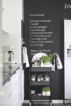 Perfect. Love the chalkboard wall and the ikea industrial chic kitchen cart. trolley