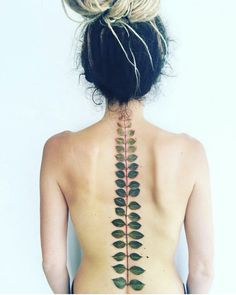 Love this tattoo idea! I've always wanted a plant along my spine