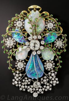 Art Nouveau Opal and Diamond Brooch. Composed of black opals, white opals, diamonds and rare demantoid garnets. #ArtNouveau #brooch