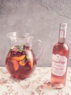 This rose sangria recipe is a twist on the classic Spanish sangria but uses rose wine, peaches and raspberries.#rose #sangria #drink #punch #cocktail