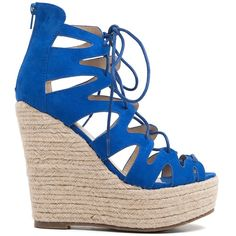 Blue suede lace-up platform with elegant cuts and rope platform decoration. Fastens with zipper at the back.