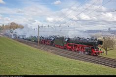 """Double traction steamtrain with the two former Deutsche Bahn """"Pacific"""" coal fired two cylinder 01 202 (Association Pacific 01 202 in Lyss, Switzerland) and haevy fuel oil fired, three cylinder 01 1066 (lettered as 012 066) of the Ulmer Eisenbahnfreunde (UEF). The train started in Munich/Germany the day before, reached Switzerland this morning in Schaffhausen and is going to Locarno. Now it running on the """"Südbahn"""" between Wohlen and Rotkreuz towards the Gotthard."""