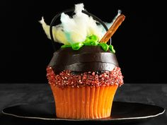 Double double, toil and trouble! This bubbling cauldron cupcake looks ALMOST too spooky to eat! #Halloween