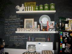 @madyago's kitchen. Chalkboard paint, ikea shelves, vintage tins, menu on the chalkboard wall.