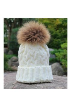 Ivory Fleece Lined Pom Pom Hat. One Size Fits Most. All Man Made Materials. Fleece Lined Hat by 6th Borough Boutique. Accessories - Hats New Jersey