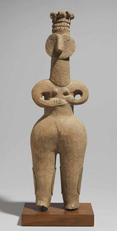 AN IRANIAN TERRACOTTA FEMALE FIGURE   CIRCA EARLY 1ST MILLENNIUM B.C.
