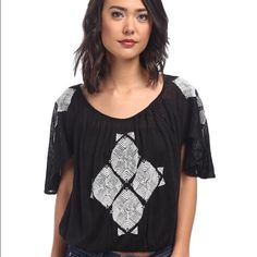 NWT Free People Top This top is a sexy little thing. Has a cute open back. Free People Tops Blouses