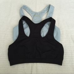 Set of 2 Champion Sports Bras Size Small Set of 2 Champion Sports Bras. Size Small. Light blue and black. In used condition. Champion Tops