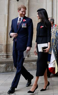 Prince Harry and his fiancee US actress Meghan Markle walk with each as they leave after attending the service