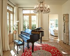 French Home Design - love the contrast of soft wall and trim shades with the black of the piano