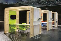open but still private...has outlets, light, internet access, LCD Screen, adjustable table height---completely movable