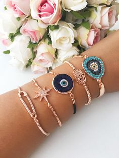 https://www.etsy.com/listing/556489433/evil-eye-bracelet-blue-evil-eye-murano Evil eye bracelet, blue evil eye murano bracelet, zirconia rose bracelet, star bracelet, safety pin bracelet, hamsa hand bracelet There is 5 type of ADJUSTABLE bracelets; 1- safety pin 2- star 3- blue murano 4- hamsa hand 5- zirconia #evileye #evileyes #blueevileye #evileyebracelet #zirconia #safetypin #murano #rosegold #hamsahand #starbracelet #bracelet #jewelry #evileyejewelry