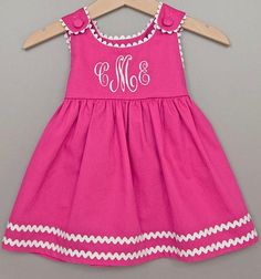 love how simple the dress really is, but the nice touched the monogram and the ric rac add to this dress