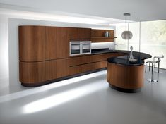 Biefbi Cucine_Timo Wood: Doors in Canaletto walnut 20 mm th. the taste of a technological living space in a contemporary reading. / Ante Noce Canaletto sp.20 mm il sapore di un ambiente tecnologico in chiave contemporanea.