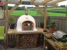 Amigo Ovens - maybe extend the pergola roof further at the oven side?