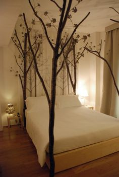Love the tree branch bed posts ind this bedroom