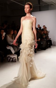 A champagne-colored wedding dress from @amsale | Brides.com