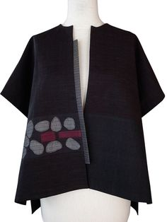 Juanita Girardin creates Japanese inspired garments for timeless fashion. See the Smithsonian Craft Show!
