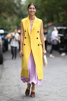NYFW Street Style Day 6: Caroline Issa was like a ray of sunshine in her sleeveless coat. nyfw #streetstyle #chic