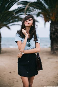 Black button down skirt and Zara blue top on the beach