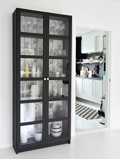 Billy bookcase with glass doors, from IKEA, great for extra dish storage in dining room