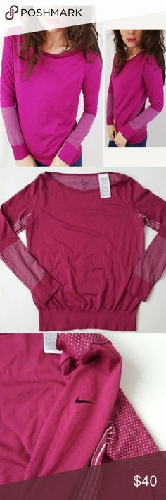 Nike dri-fit long sleeve top Medium -C1 In good condition! This is the perfect long sleeve top! Loose fit, size medium. Bright pink color with a white threading detail. Dri-fit material. Used item: pictures show any signs of wear. Inspected for quality. Bundle up! Offers always welcome:)  Check out my husband's closet: @kirchingeraaron Nike Tops