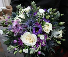 Blue and purple wedding bouquet- Thistle, roses, stocks, lissianthus and purple hydrangea