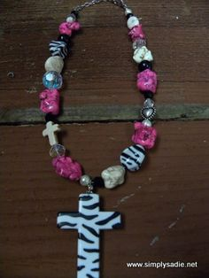 What little girl would not love this necklace?  Zebra print and pink chunky beads with a zebra print cross. Adorable....#SimplySadie #Zebra