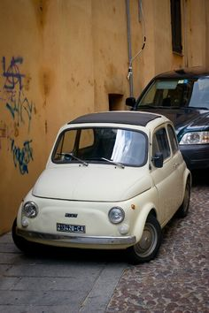 Fiat 500.  I do remember being 3 adults and 2 kids in this car for a short visit :-)